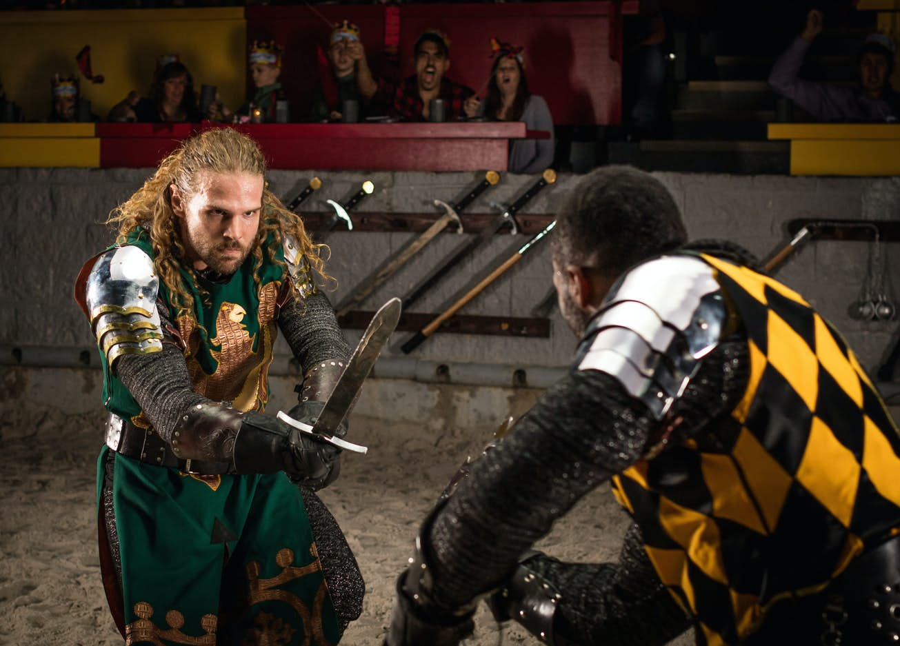 The Green Knight holding his sword out during a live Medieval Times show.