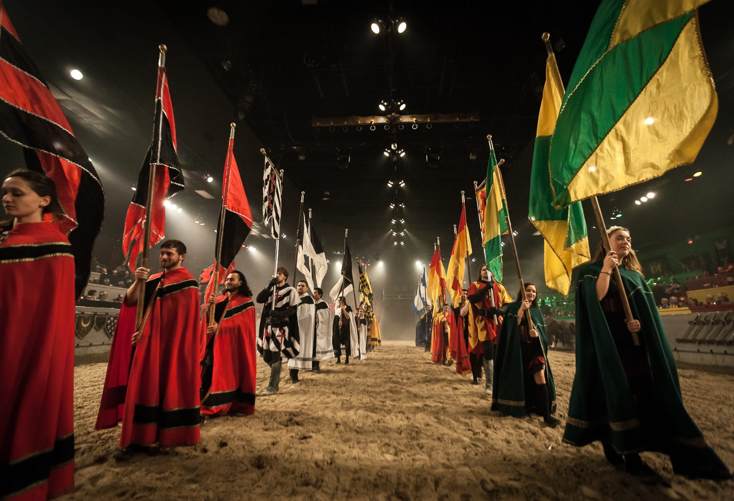 Background performers standing in a line during one of the live Medieval Times shows.